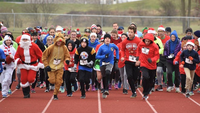 Runners take off at the start of last weekend's Caring 4 Kids Jingle Bell 5K in Waynesboro. The event raised over $1,000 for WAMS families in need.