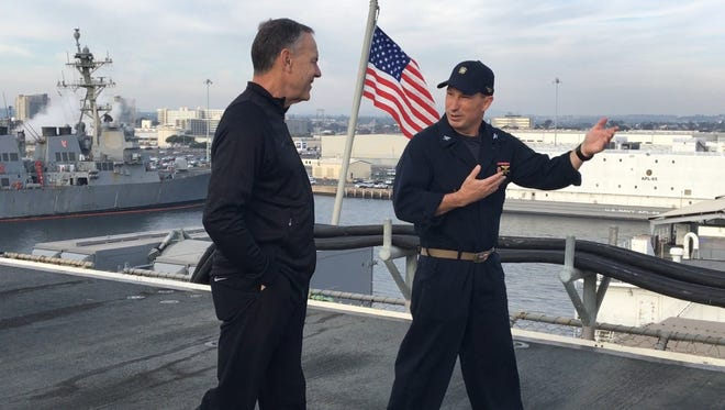 Michigan State coach Mark Dantonio, left, gets a tour of the flight deck from USS Essex commanding officer Capt. Jason Burns on Tuesday in San Diego.