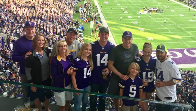 Jeff Gau, fourth from the right, with his family at a Vikings game.