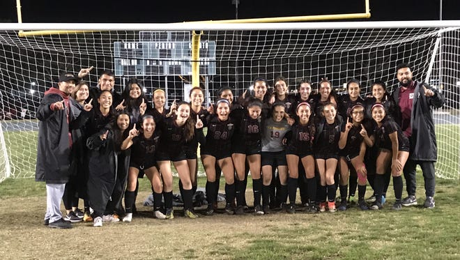 The Oxnard High girls soccer team celebrates winning its sixth straight Pacific View League title on Tuesday night at Pacifica High.