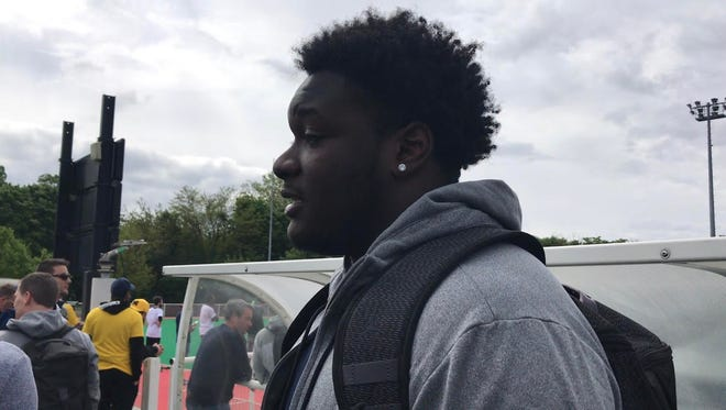 Michigan redshirt freshman tackle James Hudson speaks with reporters in Paris on April 28, 2018.