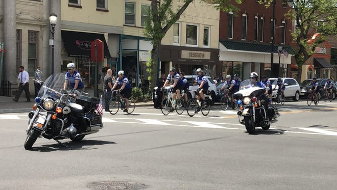 Hundreds of law enforcement officials, active and retired, rode through Somerville on Wednesday during the 2018 Police Unity Tour, which traveled through parts of Central Jersey before making its way to Washington D.C. to honor police officers who died in the line of duty.