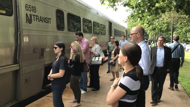 Commuters about to board an NJ Transit train to New York Penn Station