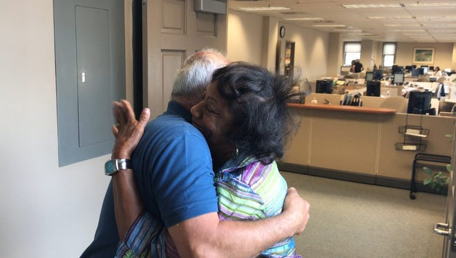 Dover Ward 4 Alderman Democratic candidate Carlos A. Valencia  embraces incumbent Ward 3 Alderman and running mate Carolyn Blackman at the Morris County Board of Elections in Morristown after a provisional ballot count turned his primary loss into a win, pending final certification. June 7, 2018