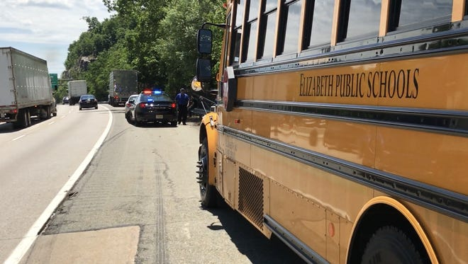 An Elizabeth school bus, car and tractor-trailer cab collided on Route 287 in Wanaque Thursday, June 21, 2018.