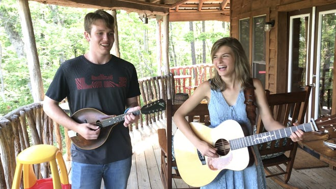 Danielle Yother and Grayson Lane play and sing on the back porch of Daniel's aunt and uncle on a mountaintop in northern Pickens County.