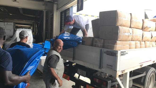 Foreign aid is loaded on trucks in St. Maarten on Wednesday, Sept. 13, 2017, a week after Hurricane Irma battered the island Sept. 6, 2017.
