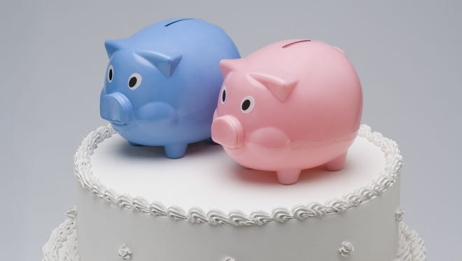 Piggy banks top this wedding cake, accurately depicting the effect the cake has on a wedding budget.