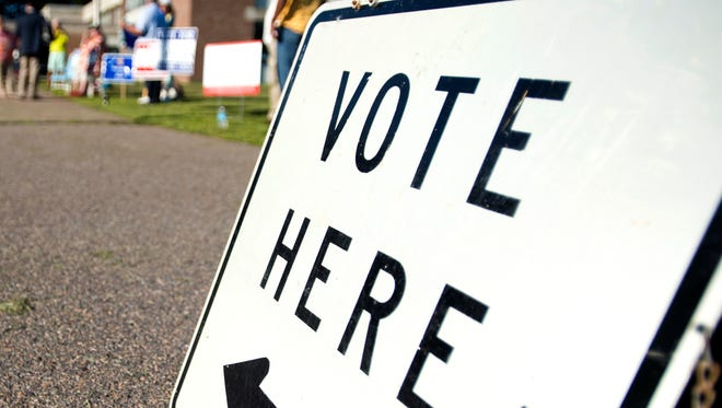 Sign directs voters to a ballot location outside of Essex Middle School.