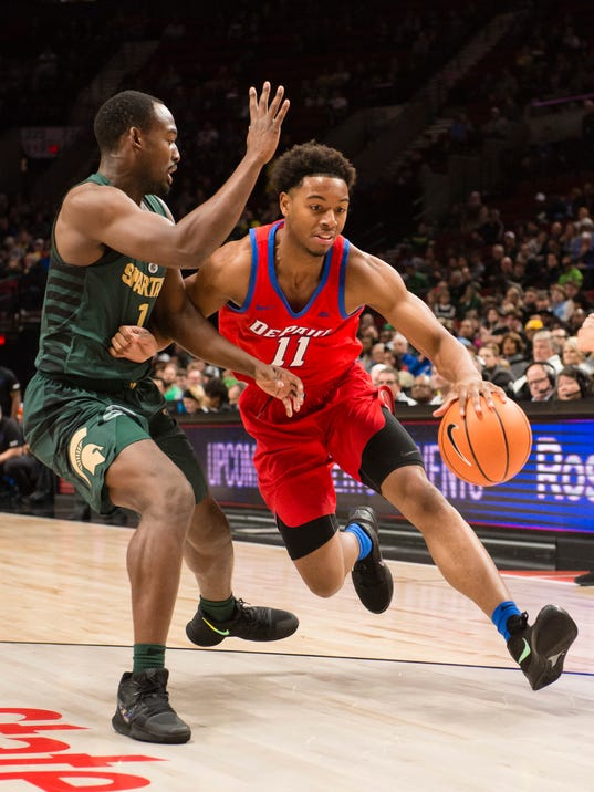 DePaul guard Eli Cain, right, drives to the basket against Michigan State guard Joshua Langford during the first half of an NCAA college basketball game at the Phil Knight Invitational Tournament in Portland, Ore., Thursday Nov. 23, 2017. (AP Photo/Troy Wayrynen)