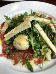 Carpaccio with hearts of palm, artichokes, capers and