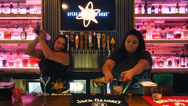 Mixologist Rachel Nez, left, and floor manager Torie Graham make drinks at the Atomic Bootlegger Lounge in Sierra Sid's Casino and Truck Stop in Sparks on Oct. 23, 2015.
