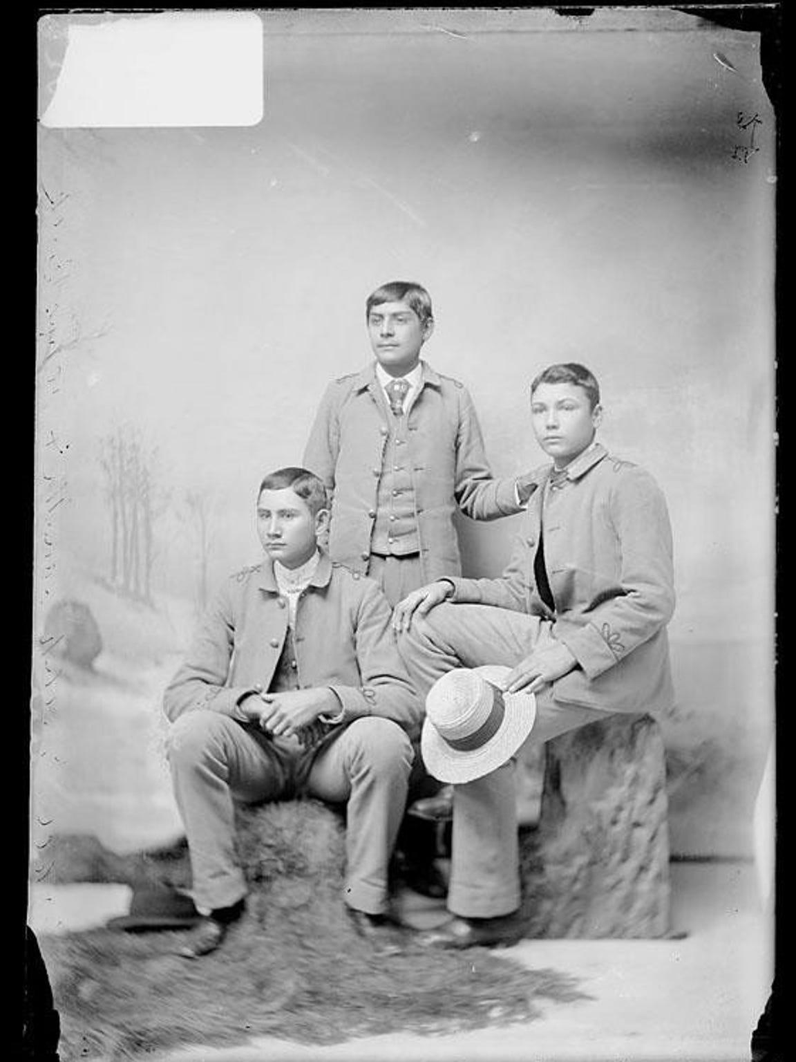 One of the few known photographs of George Ell (seated left) next to two unidentified fellow students. The photograph was likely taken shortly after Ell was enrolled at the Carlisle Indian Industrial School