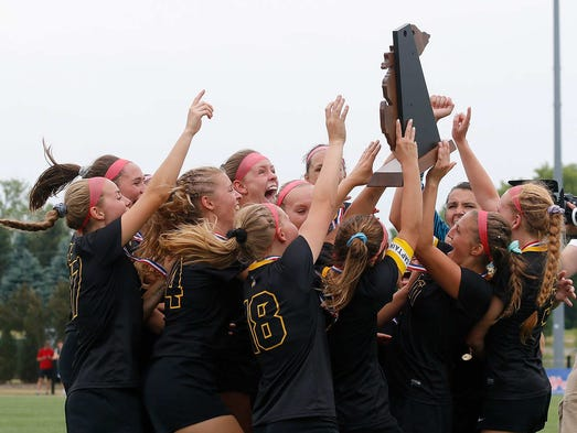 Lansing Christian players celebrate their state championship