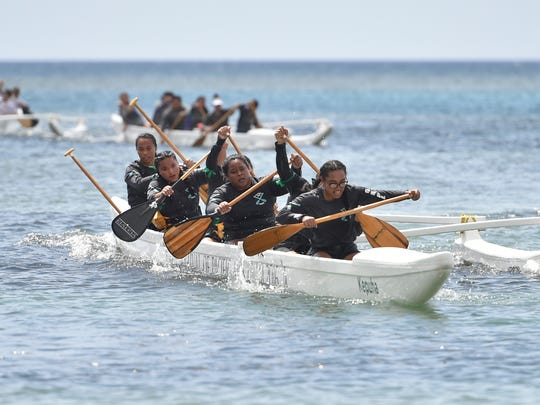 Southern High competes during the Independent Interscholastic Association of Guam and the Guam Kayak and Canoe Federation Paddling Series Manhoben Famalao'an division race at Nimitz Beach on April 22, 2017.