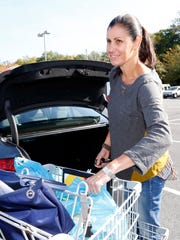Karen Parish of Pound Ridge packs up her car with groceries outside the A&P supermarket in Mount Kisco on Oct. 8. Parish said this grocery store is her main shopping location.