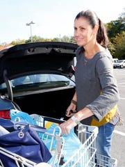 Karen Parish of Pound Ridge packs up her car with groceries