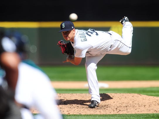 Marco Gonzalez, the Mariners' No. 5 starter,  throws
