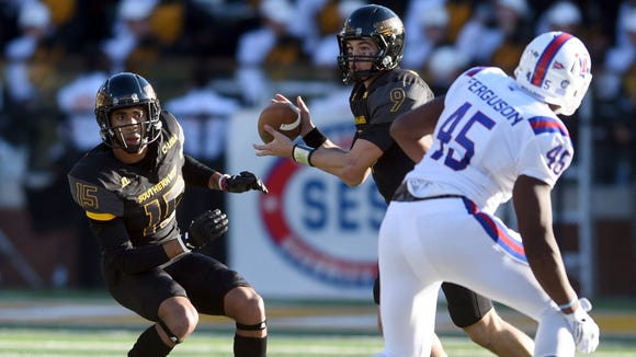 Southern Mississippi quarterback Nick Mullens searches for a receiver against Louisiana Tech during an NCAA college football game Friday, Nov. 25, 2016, in Hattiesburg, Miss. (Susan Broadbridge/Hattiesburg American via AP)