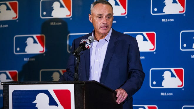 Major League Baseball Commissioner Robert Manfred takes questions from the press during media day at the Arizona Biltmore on Feb. 21, 2017.