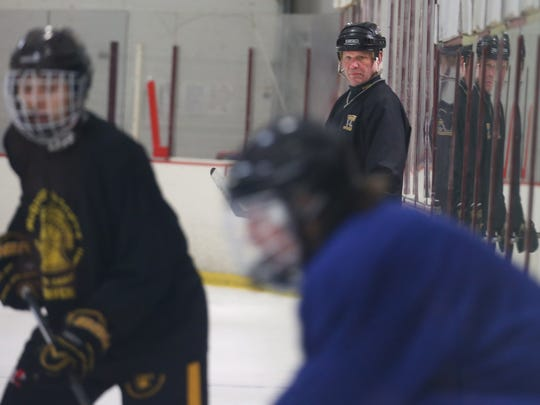 Head coach Al Vyverberg leads his McQuaid hockey squad through practice earlier this month.  Vyverberg, 62, will retire at the end of this season.
