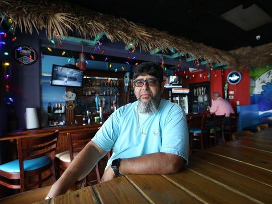 Eddie Agramonte, owner of Gordo€™s Cuban Cuisine, sits