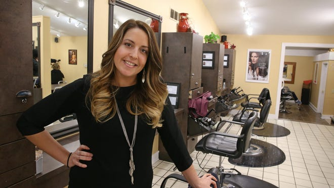 Hairdresser Katie Shane at work between appointments at Head to Toe Essentials Salon & Laser Spa in Perinton Thursday, Dec. 1, 2016.
