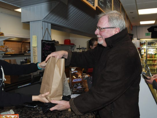 Robert Witowski of Gardiner receives his lunch in a