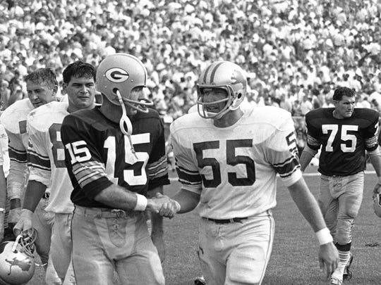 FILE - In this September 1967 file photo, Detroit Lions' Wayne Walker (55) shakes greets Green Bay Packers quarterback Bart Starr following an NFL football game in Green Bay, Wis. Walker, a Pro Bowl linebacker for the Lions and a broadcaster, has died. He was 80. The Lions say Walker died Friday, May 19, 2017. Walker said in 2015 he had Parkinson's disease. (AP Photo/File)