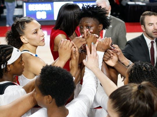 Georgia players celebrates after winning a first-round game in the NCAA women's college basketball tournament against Mercer in Athens, Ga., Saturday, March. 17, 2018. Georgia won 68-63. (AP Photo/Joshua L. Jones)