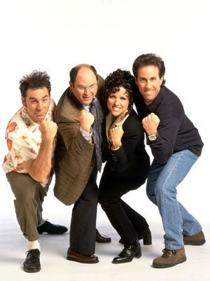 "Michael Richards as Kramer, Jason Alexander as George Costanza, Julia Louis-Dreyfus as Elaine Benes and Jerry Seinfeld as Jerry Seinfeld in a ""Seinfeld"" promo photo."