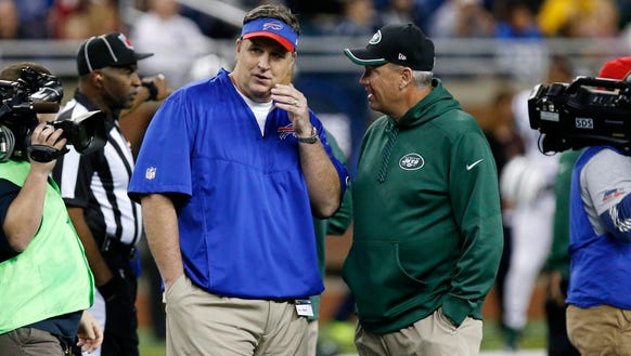 Doug Marrone and Rex Ryan talk before a game earlier