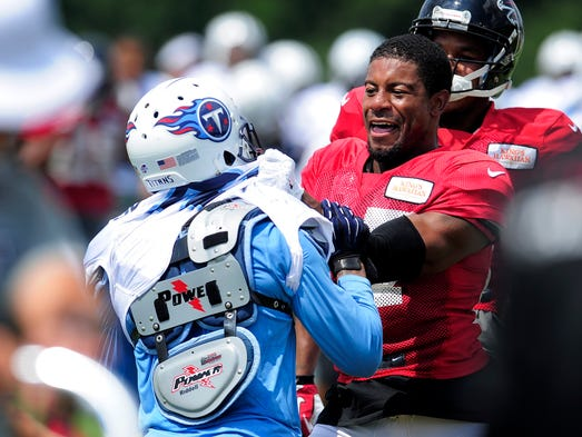 Titans cornerback Coty Sensabaugh (24) and Falcons cornerback Robert McClain (27) brawl during special-teams drills during a joint practice at the Falcons training facility on Monday in Flowery Branch, Ga.