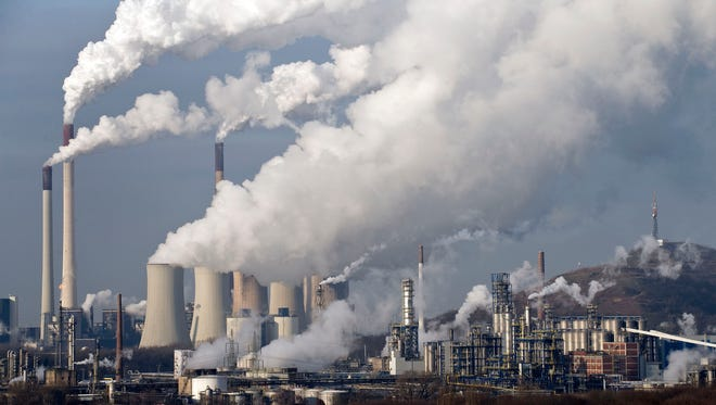 In this Wednesday, Dec. 16, 2009 file photo, steam and smoke rises from a coal-burning power plant in Gelsenkirchen, Germany.