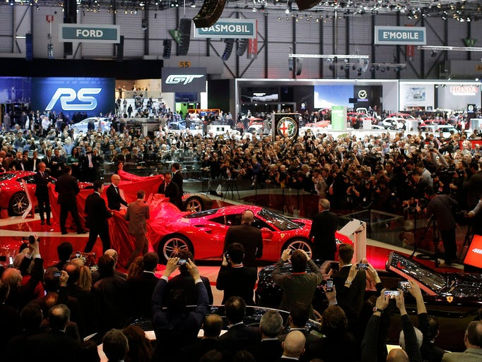 The new Ferrari 488 GTB is presented to the crowd on