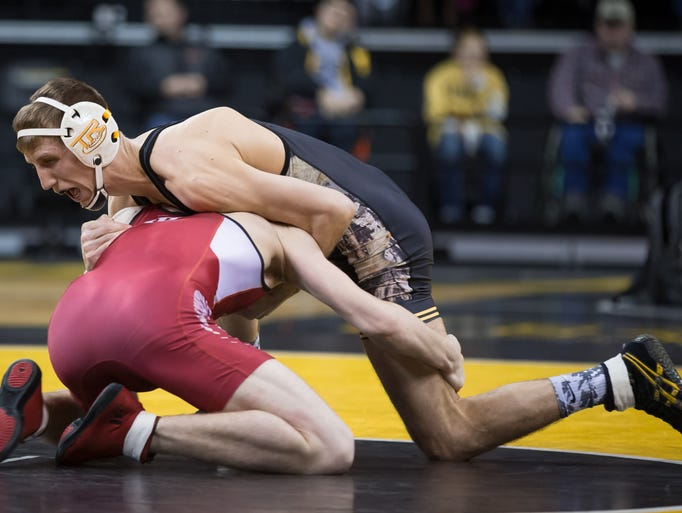 Iowa's Brody Grothus grapples with Indiana's Tommy