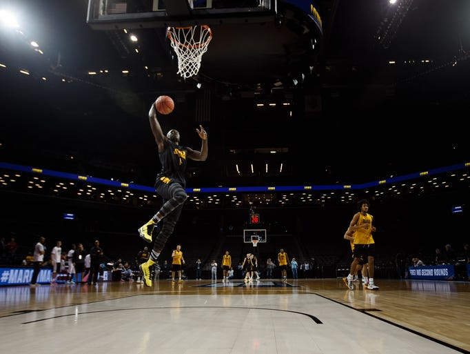 Iowa's Peter Jok dunks during Iowa's practice at the