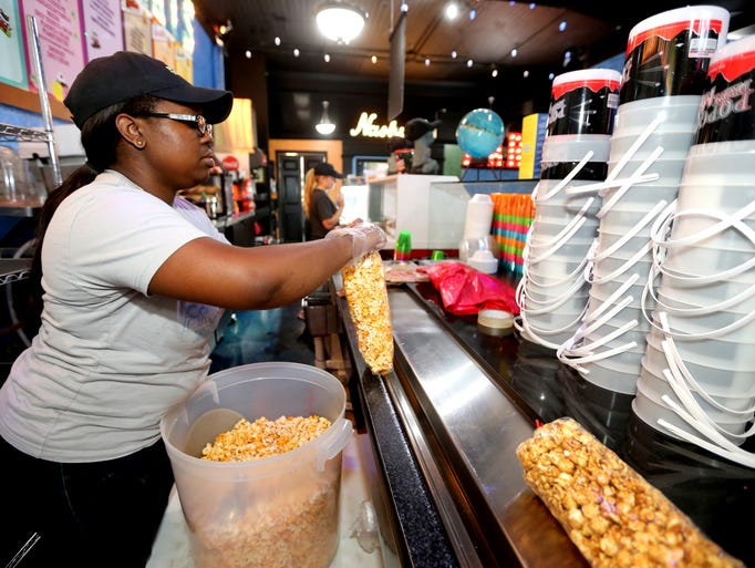 Rayna Marable bags an order of popcorn at Frozen Treats
