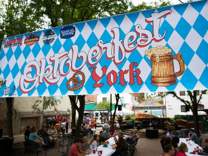 Patrons enjoy German food and beer during the Oktoberfest