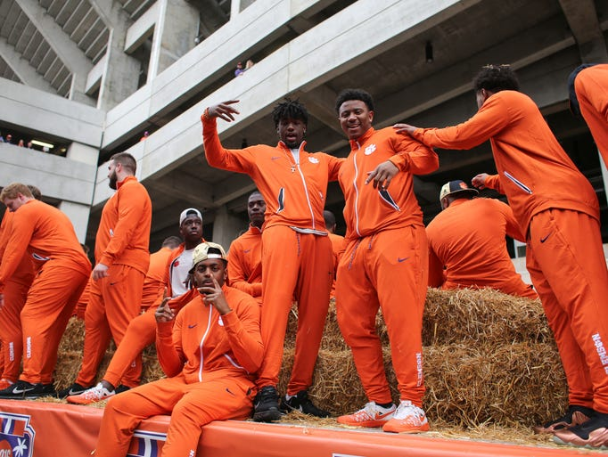 Clemson players pose during the parade Saturday celebration