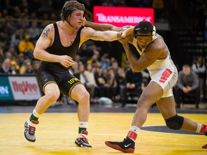 Iowa senior Sammy Brooks pushes Ohio State sophomore