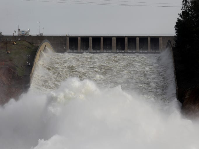 Water pours from the Oroville Dam Spillway on Monday.