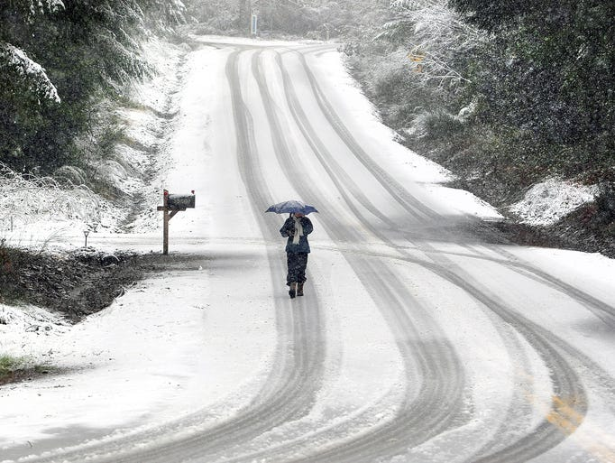 Snow covers the road on Old Sawmill Pl NW in Bremerton,