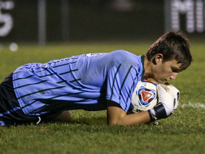 Zionsville Eagles goalkeeper Holden Brown (0) stops
