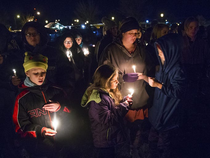 A candlelight vigil was held at a park in Aztec, New