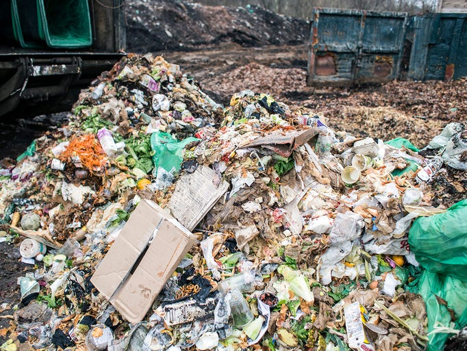 Freshly delivered food waste sits in a pile waiting