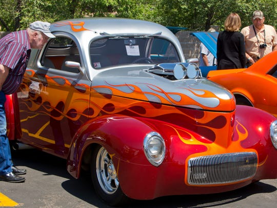 Onlookers admire Pode Bailiff's 1941 Willys coupe during the 2013 Hot August Nights pre-kickoff show and shine.