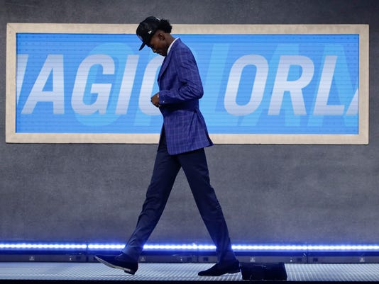 Jonathan Isaac walks off stage after being selected by the Orlando Magic as the sixth pick overall during the NBA basketball draft, Thursday, June 22, 2017, in New York. (AP Photo/Frank Franklin II)