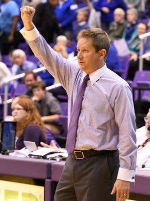 Furman head basketball coach Niko Medved.
