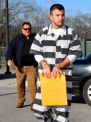 In this March 15, 2017 photo, Evan Miller, foreground, is escorted to the Lawrence County Courthouse in Moulton. Miller was convicted at the age of 14 for the 2003 murder of Cole Cannon. At the resentencing hearing, Miller's lawyers cited his childhood of physical abuse and neglect and argued that at 14, his brain wasn't fully developed. The prosecution said his actions were those of an adult who acted mercilessly. (John Godbey/The Decatur Daily via AP)